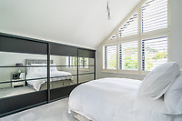 BNPS.co.uk (01202 558833)<br /> Pic: ShorePartnership/BNPS<br /> <br /> Pictured: A bedroom.<br /> <br /> A brand new waterfront home perfect for paddleboarders is on the market for £1.3m.<br /> <br /> Creek View is built on a former boatyard and has direct water access to Restronguet Creek from steps in the back garden.<br /> <br /> The contemporary four-bedroom house has an open-plan living space and floor-to-ceiling glass overlooking the water to make the most of its stunning location.