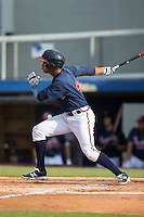 Derian Cruz (4) of the Danville Braves follows through on his swing against the Pulaski Yankees at American Legion Post 325 Field on July 31, 2016 in Danville, Virginia.  The Yankees defeated the Braves 8-3.  (Brian Westerholt/Four Seam Images)