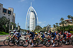 The peloton passes by the Burj Al Arab during Stage 6 of the 2021 UAE Tour running 165km from Deira Island to Palm Jumeirah, Dubai, UAE. 26th February 2021.<br /> Picture: LaPresse/Fabio Ferrari   Cyclefile<br /> <br /> All photos usage must carry mandatory copyright credit (© Cyclefile   LaPresse/Fabio Ferrari)