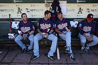 OAKLAND, CA - JUNE 5:  Nick Punto #8, Joe Mauer #7 and coach Steve Liddle #9 of the Minnesota Twins get ready in the dugout before the game against the Oakland Athletics at the Oakland-Alameda County Coliseum on June 5, 2010 in Oakland, California. Photo by Brad Mangin