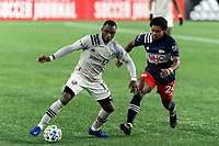 FOXBOROUGH, MA - NOVEMBER 20: Mason Toye #13 of Montreal Impact dribbles as DeJuan Jones #24 of New England Revolution closes during the Audi 2020 MLS Cup Playoffs, Eastern Conference Play-In Round game between Montreal Impact and New England Revolution at Gillette Stadium on November 20, 2020 in Foxborough, Massachusetts.