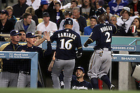 Milwaukee Brewers Manager Ron Roenicke #10 welcomes Aramis Ramirez #16 and Nyjer Morgan #2 after they scored during a game against the Los Angeles Dodgers at Dodger Stadium on May 31, 2012 in Los Angeles,California. Milwaukee defeated Los Angeles 6-2.(Larry Goren/Four Seam Images)