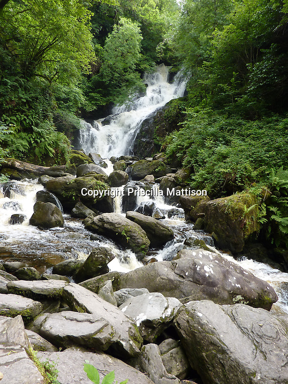 County Kerry, Republic of Ireland - July 19, 2010:  Water flows over boulders at Torc Waterfall in  Killarney National Park.