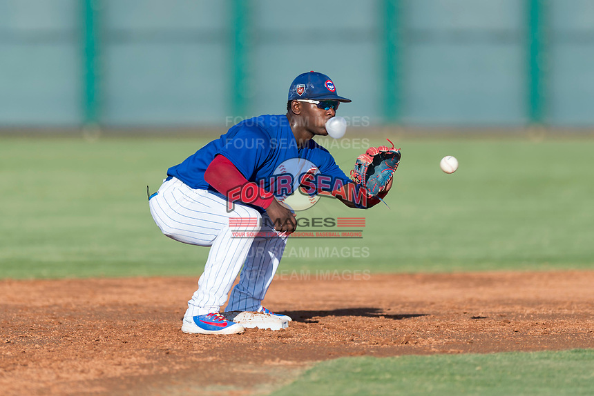 AZL Cubs 1 second baseman Yonathan Perlaza (12) waits to receive a throw during an Arizona League game against the AZL Indians 1 at Sloan Park on August 27, 2018 in Mesa, Arizona. The AZL Cubs 1 defeated the AZL Indians 1 by a score of 3-2. (Zachary Lucy/Four Seam Images)