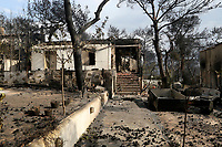 Pictured: A burned house in the aftermath of the forest fire which has claimed dozens of lives in the Mati area of Rafina, Greece. Tuesday 24 July 2018<br /> Re: Deaths caused by wild forest fires throughout Greece.