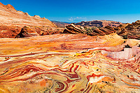 Amazing sedimentary rock colors near iconic The Wave formation, in North Coyote buttes of Paria Canyon, at the Arizona and Utah border USA