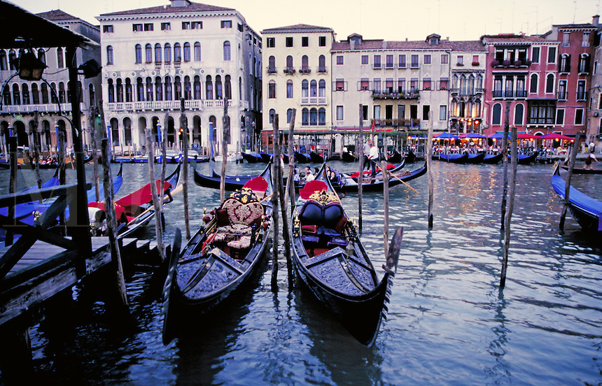 The gondolas lined up and waiting in Venice, Italy cityscape, urban structure, boat, boats, transportation, architecture, waterways. Venice, Italy.