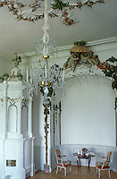 The boudoir features painted ornate stucco, a pair of chairs and a table set with Meissen porcelain