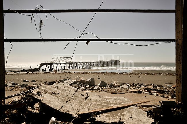 Chile, Aftermath of the tsunami in the area of Consitucion. Rests of a pier and a fish market.