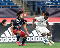 FOXBOROUGH, MA - SEPTEMBER 1: Shak Adams #17 of FC Tucson dribbles at midfield as Ryan Spaulding #34 of New England Revolution II defends during a game between FC Tucson and New England Revolution II at Gillette Stadium on September 1, 2021 in Foxborough, Massachusetts.