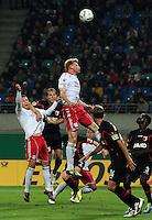 Fussball, DFB-Pokal 2. Runde, Saison 2011/2012, RB Leipzig - FC Augsburg, Dienstag (25.10.11), Red Bull Arena, Leipzig: Strafraumszene Fabian Franke (m. , RB) steigt in die Höhe empor.<br /> Foto: aif / Norman Rembarz