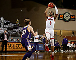 SIOUX FALLS, SD - MARCH 6: Stanley Umude #0 of the South Dakota Coyotes shoots over Colton Sandage #20 of the Western Illinois Leathernecks during the Summit League Basketball Tournament at the Sanford Pentagon in Sioux Falls, SD. (Photo by Dave Eggen/Inertia)
