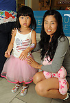 Carolyn Liu and Quing Li, 3, at the MD Anderson Back to School Fashion Show at The Galleria Saturday August 17, 2013.(Dave Rossman photo)