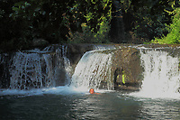 """A tourist (me, the photo is taken by a friend of mines) who is swimmeng near to the small waterfall. This makes part of the Treja river, in a natural landscape with abundant green vegetation. It is among the main characteristics of the locality that is called """"Monte Gelato"""" (the chilled mountain), near Rome, that belongs to a Natural Reserve. <br /> <br /> You can download this file for (E&PU) only, but you can find in the collection the same one available instead for (Adv)."""