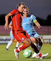 Abby Wambach (20) of the Washington Freedom is marked by Christie Rampone (3) of Sky Blue FC. Sky Blue FC and the Washington Freedom played to a 4-4 tie during a Women's Professional Soccer match at Yurcak Field in Piscataway, NJ, on July 15, 2009.
