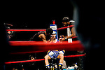 Masami Hibino rests after round 2. She will easily beat Holly Stevens for the title. .Thursday was the first night of the finals of the  79th annual Golden Glove Boxing tournament. Boxers from all over the New York who made it through the previous rounds were on hand at Madison Square Garden to compete for the coveted Golden Gloves Champion title.
