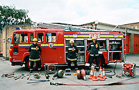 A group shot of a fire crew. They are posing in front of their fire engine. Laid out in front of them is part of the road traffic extrication equipment carried by the appliance...© SHOUT. THIS PICTURE MUST ONLY BE USED TO ILLUSTRATE THE EMERGENCY SERVICES IN A POSITIVE MANNER. CONTACT JOHN CALLAN. Exact date unknown.john@shoutpictures.com.www.shoutpictures.com....