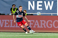 FOXBOROUGH, MA - AUGUST 29: Alexander Buttner #28 of New England Revolution passes the ball during a game between New York Red Bulls and New England Revolution at Gillette Stadium on August 29, 2020 in Foxborough, Massachusetts.