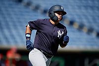 New York Yankees Stanley Rosario (24) runs to first base during a Florida Instructional League game against the Philadelphia Phillies on October 12, 2018 at Spectrum Field in Clearwater, Florida.  (Mike Janes/Four Seam Images)