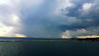 WEATHER PICTURE<br /> Dark clouds and rain over Oropos, Greece. The country has been experiencing recent heatwaves. Thursday 27 July 2017