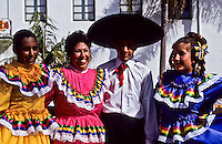 A group of mexican flamingo dancers in traditional costumes