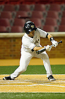 Pat Blair #11 of the Wake Forest Demon Deacons lays down a bunt against the Florida State Seminoles at Wake Forest Baseball Park on March 24, 2012 in Winston-Salem, North Carolina.  The Seminoles defeated the Demon Deacons 3-2.  (Brian Westerholt/Four Seam Images)