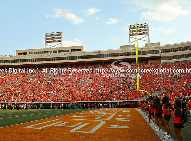 Oklahoma State Cowboys fans dominate the stadium during the game between the Louisiana-Lafayette Ragin Cajuns and the Oklahoma State Cowboys at the Boone Pickens Stadium in Stillwater, OK. Oklahoma State defeats Louisiana-Lafayette 61 to 34.