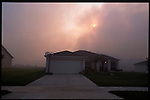 May 27, 2001. In Groveland new homes are in the shadow  of local wildfires. Groveland once used to be an area of orange groves now is suburban sprawl.