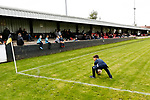 A young fan retrieves his ball from the pitch. Hucknall Town v Heanor Town, 17th October 2020, at the Watnall Road Ground, East Midlands Counties League. Photo by Paul Thompson.