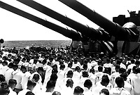 The crew of the USS SOUTH DAKOTA stands with bowed heads, while Chaplain N.D. Lindner reads the benediction held in honor of fellow shipmates killed in the air action of Guam on June 19, 1944.  (Navy)<br /> NARA FILE #:  026-G-4677<br /> WAR & CONFLICT BOOK #:  929