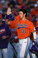 Center fielder Bryce Teodosio (31) of the Clemson Tigers is congratulated after scoring a run in a game against the William and Mary Tribe on February 16, 2018, at Doug Kingsmore Stadium in Clemson, South Carolina. Clemson won, 5-4 in 10 innings. (Tom Priddy/Four Seam Images)