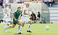 Katie Larkin (white) chased by Lori Chalupny...Saint Louis Athletica and LA Sol, played to a 0-0 tie at Robert Hermann Stadium in St Louis, MO. April 25 2009.