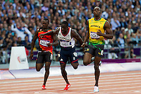 05 AUG 2012 - LONDON, GBR - Usain Bolt (JAM) of Jamaica beats Daniel Bailey (ANT) of Antigua (left) and Dwain Chambers (GBR) (centre) of Great Britain during his men's 100m semi final during the London 2012 Olympic Games athletics in the Olympic Stadium at the Olympic Park in Stratford, London, Great Britain .(PHOTO (C) 2012 NIGEL FARROW)