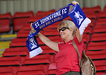 St Johnstone v Fleetwood Town…24.07.21  McDiarmid Park<br />A fan shows her support as the players take a lap of honour at McDiarmid Park showing the fans the two trophies<br />Picture by Graeme Hart.<br />Copyright Perthshire Picture Agency<br />Tel: 01738 623350  Mobile: 07990 594431