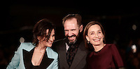 """French actress Juliette Binoche (L), British actor Ralph Fiennes (C) and British actress Kristin Scott Thomas (R), pose on the red carpet as they arrive for a special screening of the movie """"The English Patient"""" during the international Rome Film Festival at Rome's Auditorium, 22 October 2016. The Film Festival celebrates one of the most beloved of Cinema History 'The English Patient' by Anthony Minghella, released twenty years ago (in 1996). <br /> UPDATE IMAGES PRESS/Isabella Bonotto"""