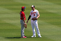 Baltimore Orioles Trey Mancini (16) talks with Matt Vierling (76) before a Major League Spring Training game against the Philadelphia Phillies on March 12, 2021 at the Ed Smith Stadium in Sarasota, Florida.  (Mike Janes/Four Seam Images)