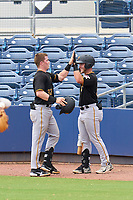 FCL Pirates Black Henry Davis (32) high fives Jake Wright (right) after hitting a two run home run, the first of his professional career, to opposite field in the top of the fourth inning during a game against the FCL Rays on August 3, 2021 at Charlotte Sports Park in Port Charlotte, Florida.  Davis was making his professional debut after being selected first overall in the MLB Draft out of Louisville by the Pittsburgh Pirates.  (Mike Janes/Four Seam Images)