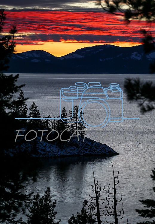 The sun sets over Lake Tahoe near Carson City, Nev., on Wednesday, Jan. 23, 2019. Photo by Cathleen Allison/Nevada Momentum