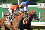 """Martin Garcia aboard Coil (Winner) looks at Jesus Castanon aboard Preakness Stakes winner Shackleford """"Who Won?""""  Haskell Invitational Stakes (Grade I) apart of the Breeders Cup  Classic Win and You're In  at  Monmouth Park Racetrack in Oceanport, NJ  on 7/31/11. (Ryan Lasek / Eclipse Sportwire)"""