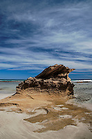 A rock formation of sandstone stands at the edge of the ocean, Kangaroo Island.