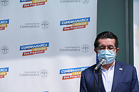 BOGOTA - COLOMBIA, 18-02-2021: Fernando Ruiz, ministro de salud de Colombia durante la primera jornada de vacunación contra el COVID-19 (Coronavirus) que se llevo a cabo en la clínica Colombia en la ciudad de Bogotá. Son las primeras 50.000 vacunas de la farmacéutica Pfizer y que representan un 0.08% de las requeridas en Colombia fueron distribuidas en diferentes ciudades del país para comienzan su aplicación en personal de la salud que son los más expuestos al contagio del Coronavirus. / fernando Ruiz health minister of Colombia during the first day of vaccination against COVID-19 (Coronavirus) that took place at the Colombia clinic in the city of Bogotá. They are the first 50,000 vaccines from the pharmaceutical company Pfizer that represent 0.08% of those required in Colombia and were distributed in different cities of the country to begin their application in health personnel who are the most exposed to the contagion of the Coronavirus. Photo: VizzorImage / Johan Rugeles / Cont