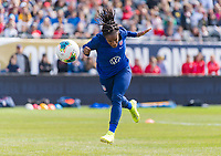 CHICAGO, IL - OCTOBER 5: Crystal Dunn #19 of the United States heads the ball at Soldier Field on October 5, 2019 in Chicago, Illinois.
