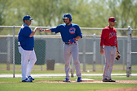 Chicago Cubs first baseman Cam Balego (9) is congratulated by a coach during a Minor League Spring Training game against the Los Angeles Angels at Sloan Park on March 20, 2018 in Mesa, Arizona. (Zachary Lucy/Four Seam Images)