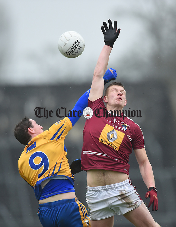 Cathal O Connor of Clare in action against John Heslin of Westmeath during their league game in Cusack Park. Photograph by John Kelly.