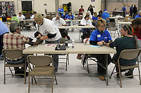 Triage area, taking blood presure and pulse from new arrrivals, at the Remote Area Medical (RAM) clinic. Over the weekend at Soft Shell, Knott County, in the Appalachian mountains of eastern Kentucky, the congressional district with the nation's lowest life expectancy, RAM volunteers saw 822 needy people. 95 percent of people seen were provided with dental or optical care. RAM was founded in 1985 to provide free health, dental and eye care in the developing world. However, RAM now provides 60 percent of its services in the US, providing for the estimated 47 million Americans without health insurance..