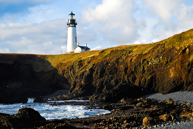 """""""YAQUINA HEAD""""<br /> <br /> Yaquina Head lighthouse stands in cloudy blue skies watching over the rocky Oregon Coast"""