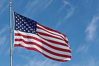 Photo of sunlit American flag waving in the wind on the Memorial Day Holiday.
