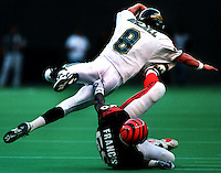 Cincinnati Bengals linebacker #50 James Francis grabs Jaguars quarterback Mark Brunell by the seat of his pants and flings him through the air for a sack Sunday afternoon.