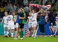 USWNT defender (17) Lori Chalupny celebrates the win with her teammates after playing for the gold medal at Workers' Stadium.  The USWNT defeated Brazil, 1-0, during the 2008 Beijing Olympic final in Beijing, China.