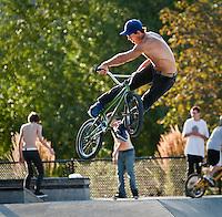 Expert, BMX biker flips bike on an extreme Jump.